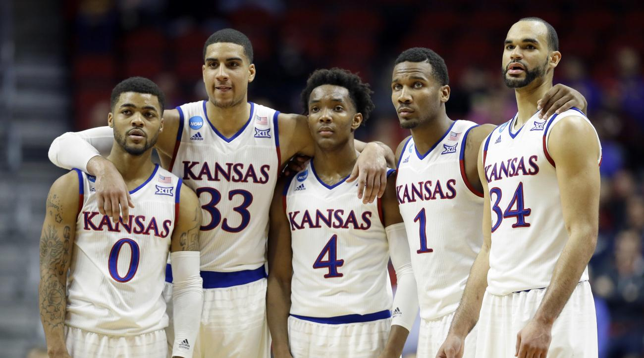 Kansas' Frank Mason III (0), Landen Lucas (33), Devonte' Graham (4), Wayne Selden Jr. (1) and Perry Ellis (34) gather during the second half of a second-round men's college basketball game against Connecticut in the NCAA Tournament, Saturday, March 19, 20