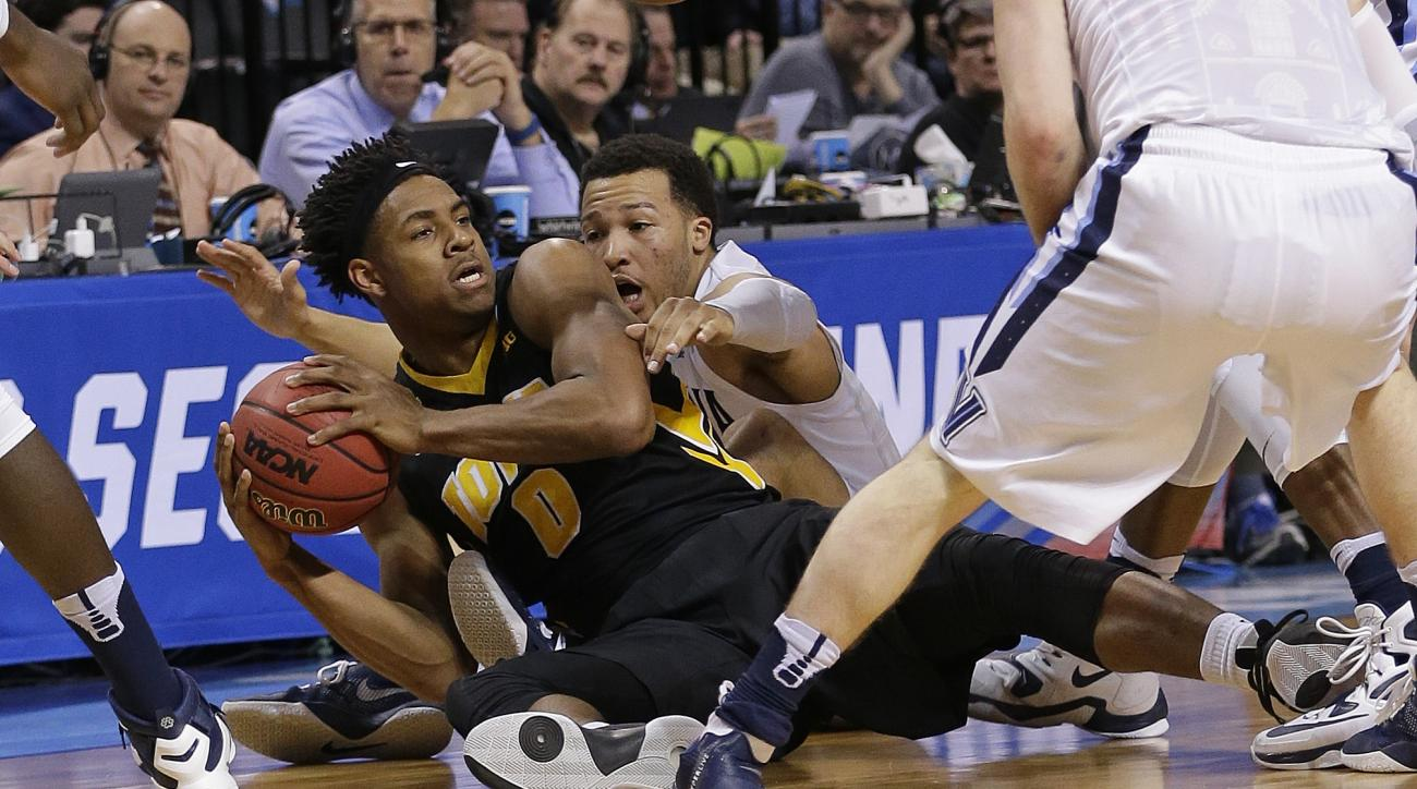 Iowa's Ahmad Wagner (0) protects the ball from Villanova's Jalen Brunson (1) during the second half of a  second-round men's college basketball game in the NCAA Tournament, Sunday, March 20, 2016, in New York. (AP Photo/Frank Franklin II)
