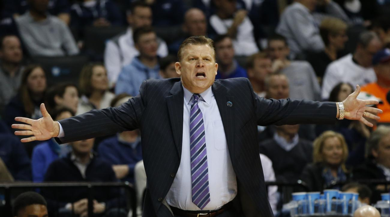 Stephen F. Austin head coach Brad Underwood gestures toward the referee during the first half of a second-round NCAA men's college basketball tournament game against Notre Dame, Sunday, March 20, 2016, in New York. (AP Photo/Kathy Willens)