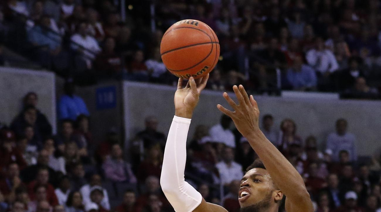 Oklahoma guard Buddy Hield (24) shoots over VCU guard JeQuan Lewis (1) in the second half during a second-round men's college basketball game in the NCAA Tournament in Oklahoma City, Sunday, March 20, 2016. Oklahoma won 85-81. (AP Photo/Alonzo Adams)