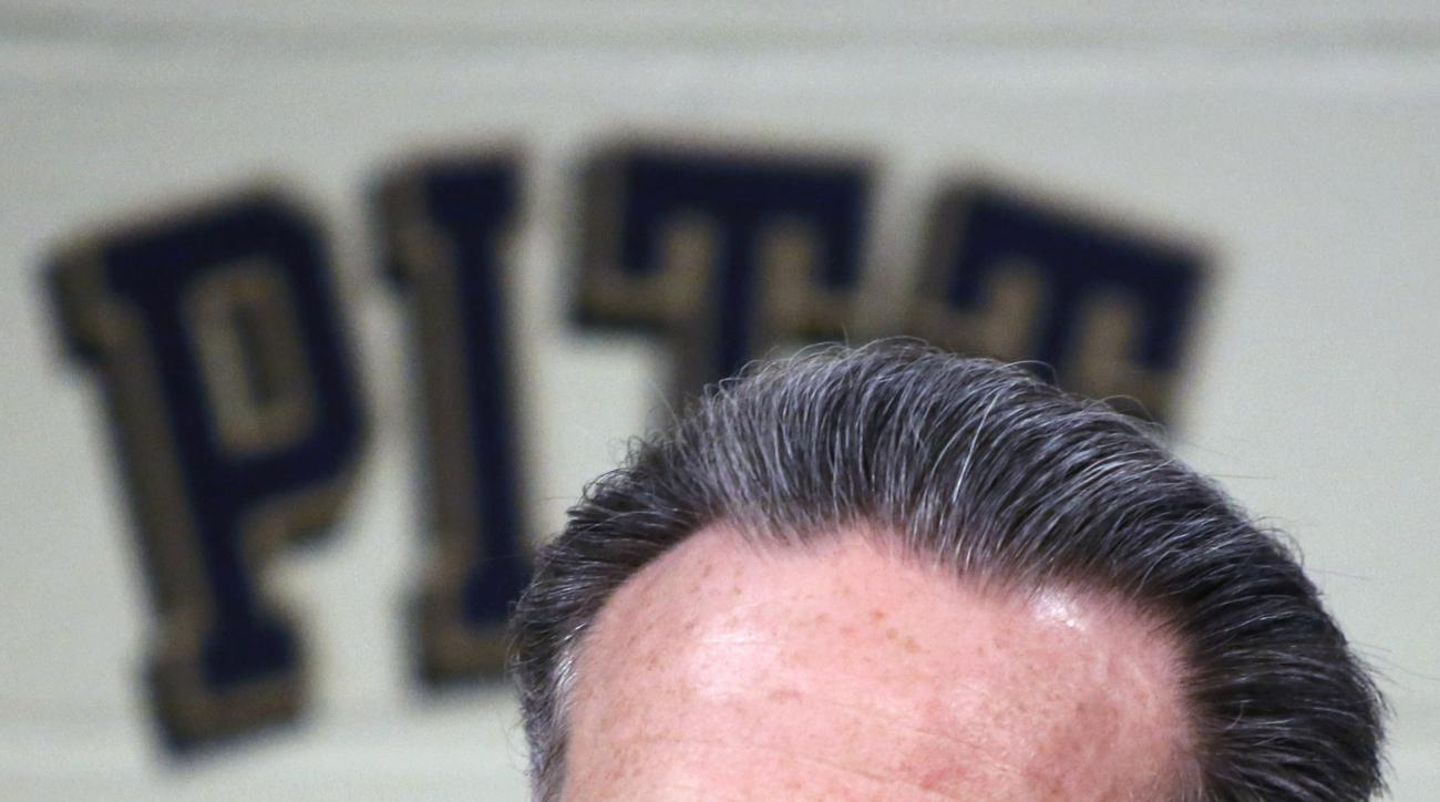 File-This Oct. 2, 2014, file photo shows Pittsburgh head coach Jamie Dixon taking questions during a news conference during the school's annual media day for the upcoming NCAA college basketball season in Pittsburgh. On Monday, March 21, 2016, fresh off a