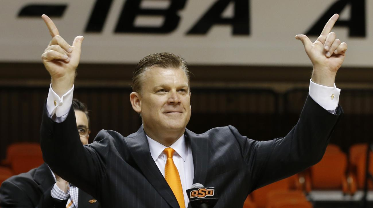 Oklahoma State's new men's basketball Brad Underwood gestures as he speaks after being introduced during an NCAA college basketball news conference in Stillwater, Okla., Wednesday, March 23, 2016. (AP Photo/Sue Ogrocki)