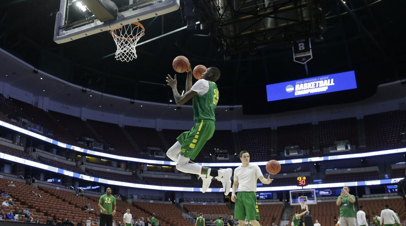 Oregon's Chris Boucher takes a shot during college basketball practice in Anaheim, Calif., Wednesday, March 23, 2016. Oregon plays against Duke in a regional semifinal game in the NCAA Tournament on Thursday. (AP Photo/Chris Carlson)