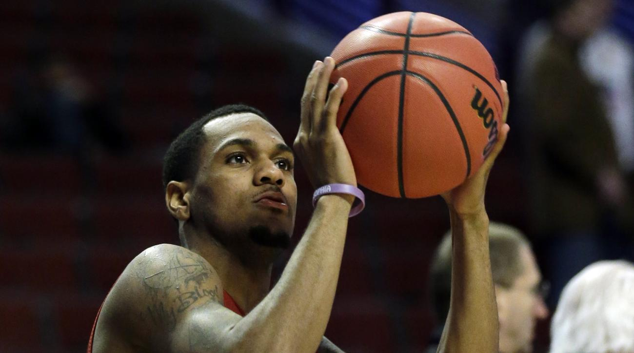 Iowa State's Monte Morris (11) shoots during college basketball practice, Thursday, March 24, 2016, in Chicago. Iowa State plays against Virginia in a regional semifinal game in the NCAA Tournament on Friday. (AP Photo/Nam Y. Huh)
