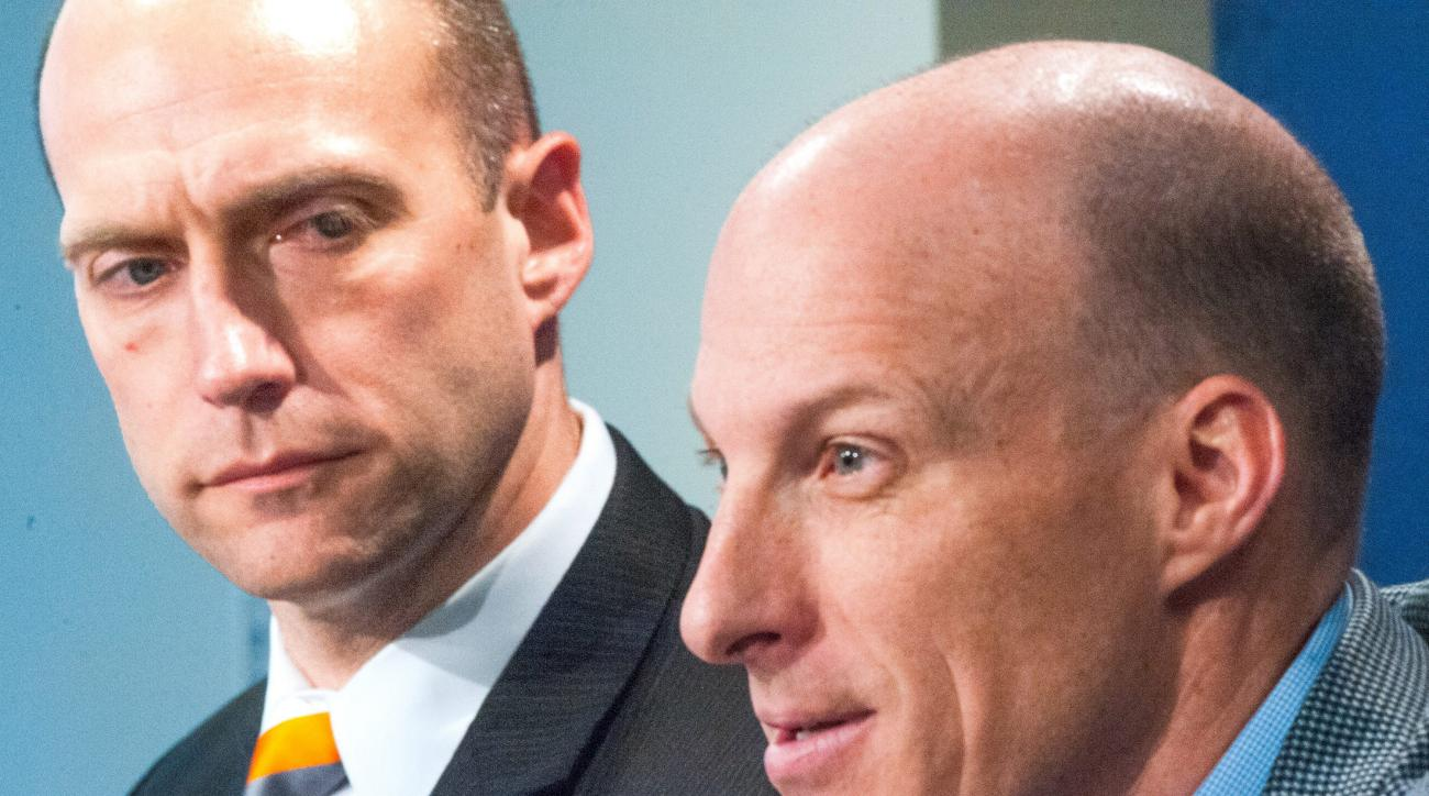Illinois men's basketball coach John Groce, speaks during an NCAA college basketball press conference with UI athletic director Josh Whitman, left, Thursday, March 24, 2016, at Memorial Stadium in Champaign, Ill. (Robin Scholz/The News-Gazette via AP)  MA