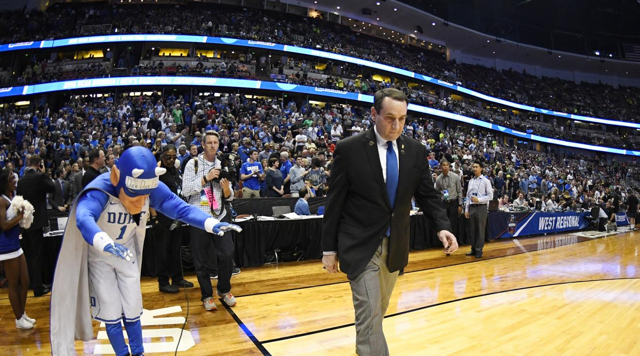 Duke head coach Mike Krzyzewski arrives for an NCAA college basketball game against Oregon in the regional semifinals of the NCAA Tournament, Thursday, March 24, 2016, in Anaheim, Calif. (AP Photo/Mark J. Terrill)
