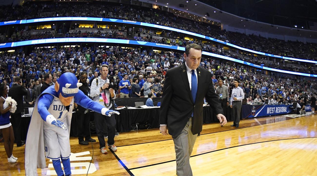 Duke head coach Mike Krzyzewski arrives for an NCAA college basketball game against Oregon in the regional semifinals of the NCAA Tournament, Thursday, March 24, 2016, in Anaheim, Calif. (AP Photo/Mark J. Terrill)