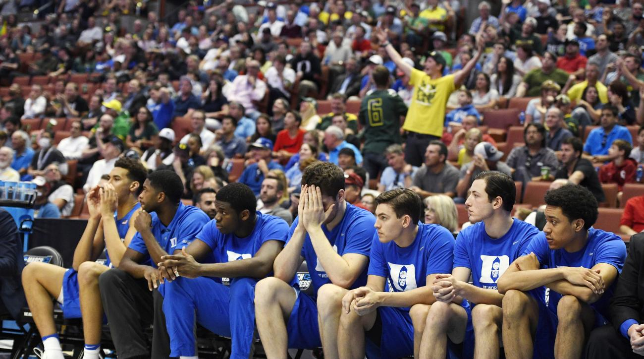 The Duke bench reacts during the second half of an NCAA college basketball game against Oregon in the regional semifinals of the NCAA Tournament, Thursday, March 24, 2016, in Anaheim, Calif. (AP Photo/Mark J. Terrill)