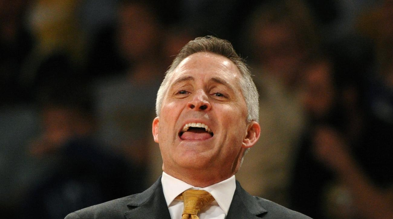 FILE - In this March 8, 2014, file photo, Georgia Tech head coach Brian Gregory disputes a foul call during the first half of an NCAA college basketball game against Virginia Tech in Atlanta. Georgia Tech has fired Gregory. The moved was announced Friday,