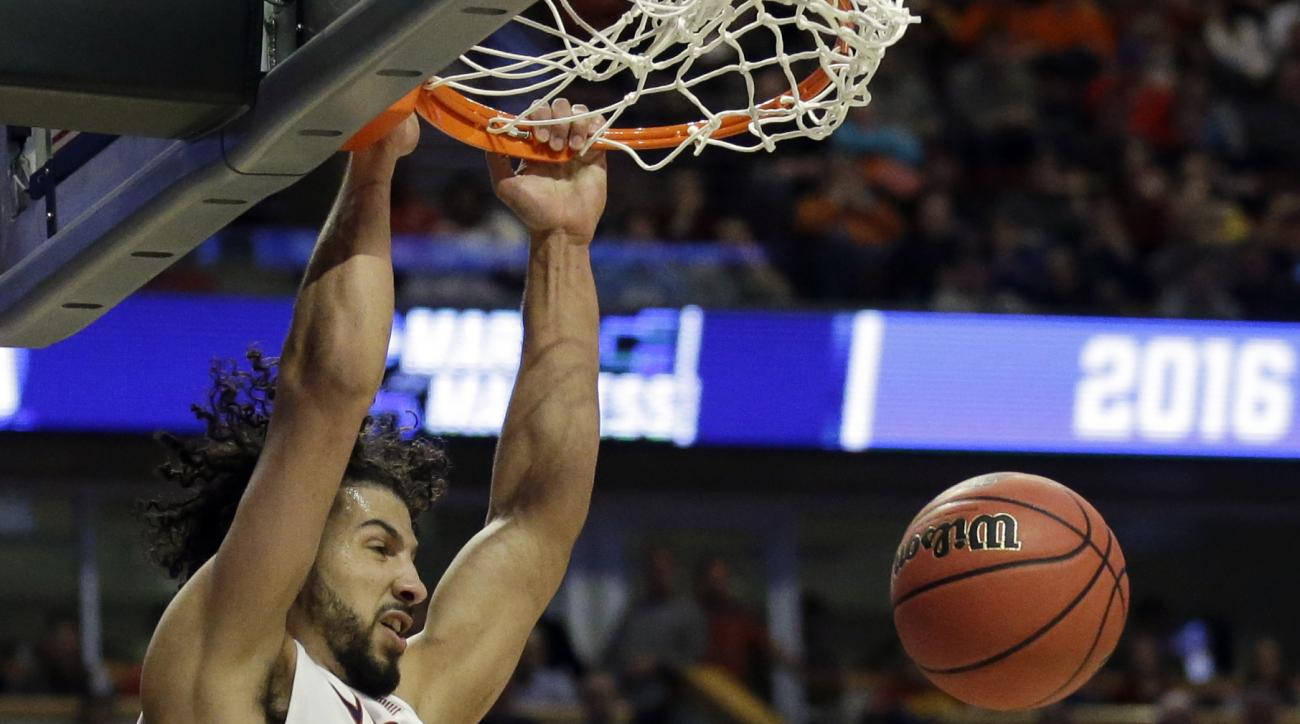 Virginia's Anthony Gill (13) dunks during the second half of a college basketball game against Iowa State in the regional semifinals of the NCAA Tournament, Friday, March 25, 2016, in Chicago. (AP Photo/Nam Y. Huh)