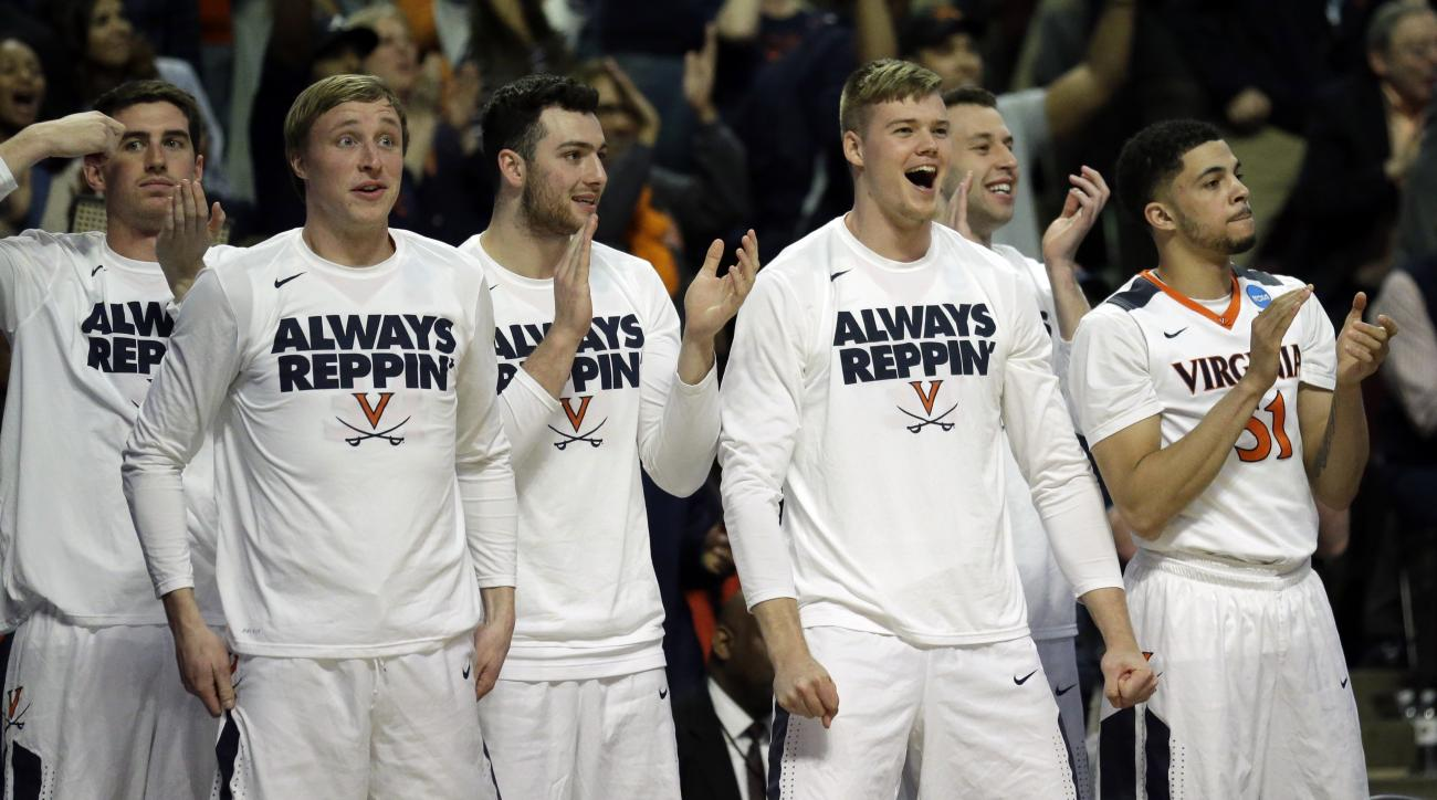 Players on Virginia bench react during the second half of a college basketball game against Iowa State in the regional semifinals of the NCAA Tournament, Friday, March 25, 2016, in Chicago. Virginia won 84-71. (AP Photo/Nam Y. Huh)