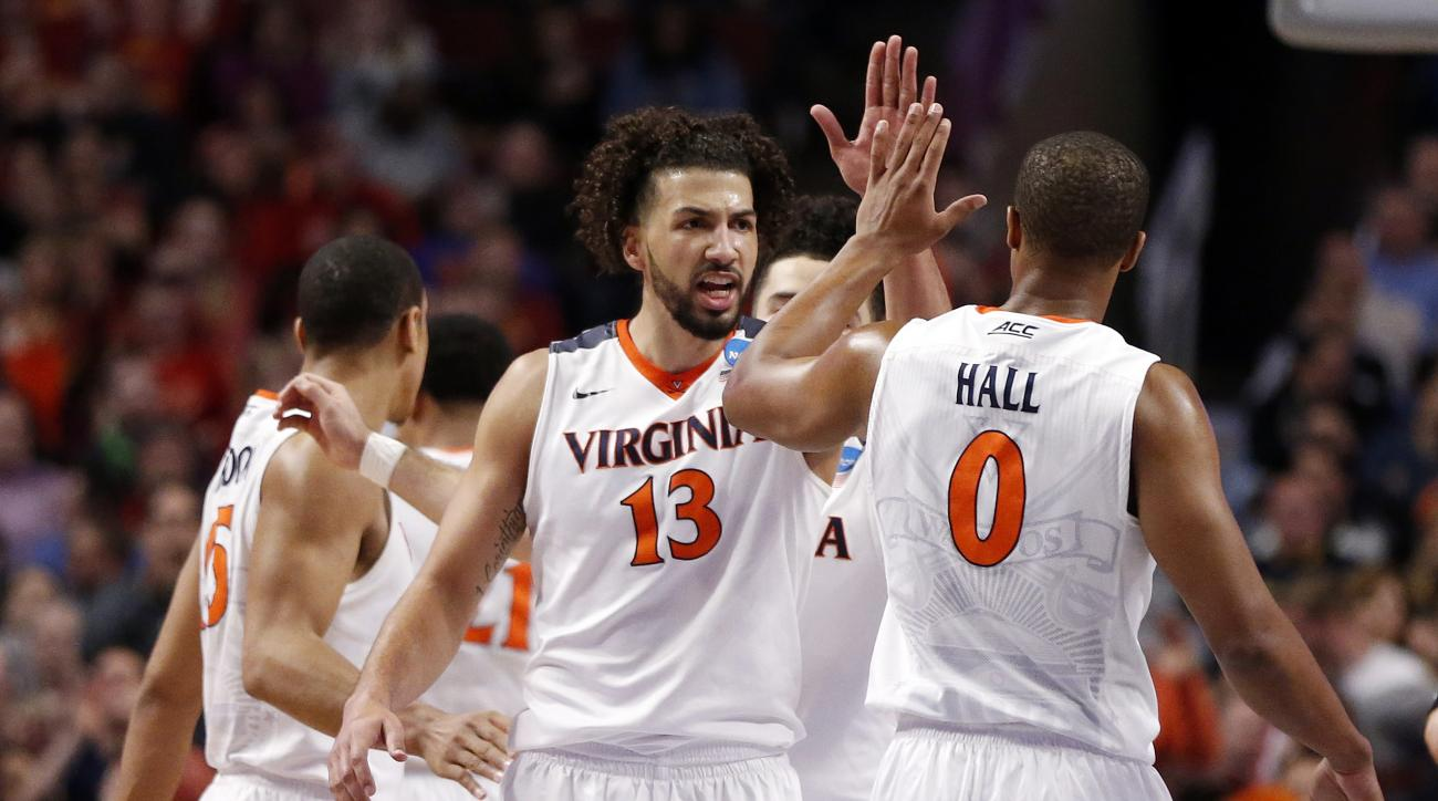 Virginia's Anthony Gill (13) high fives Virginia's Devon Hall (0) after a play during the second half of a college basketball game Iowa State in the regional semifinals of the NCAA Tournament, Friday, March 25, 2016, in Chicago. Virginia won 84-71. (AP Ph