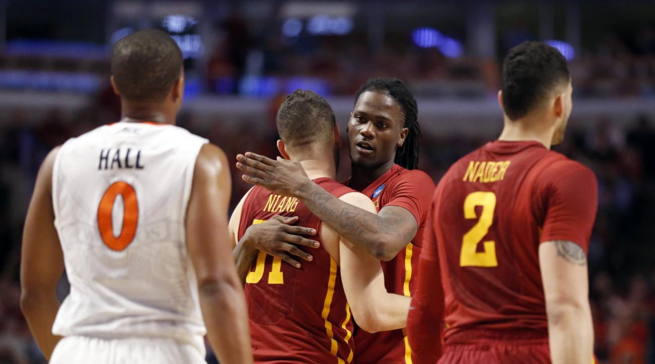 Iowa State's Jameel McKay, second from right, hugs Georges Niang (31) in the final seconds of a college basketball game in the regional semifinals of the NCAA Tournament, Friday, March 25, 2016, in Chicago. Virginia won 84-71. (AP Photo/Charles Rex Arboga