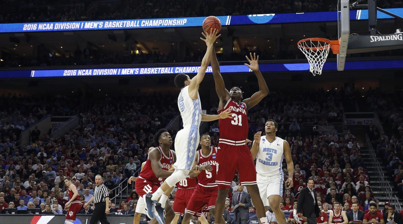 North Carolina's Marcus Paige, left, releases a shot against Indiana's Thomas Bryant during the first half of an NCAA college basketball game in the regional semifinals of the men's NCAA Tournament, Friday, March 25, 2016, in Philadelphia. (AP Photo/Matt
