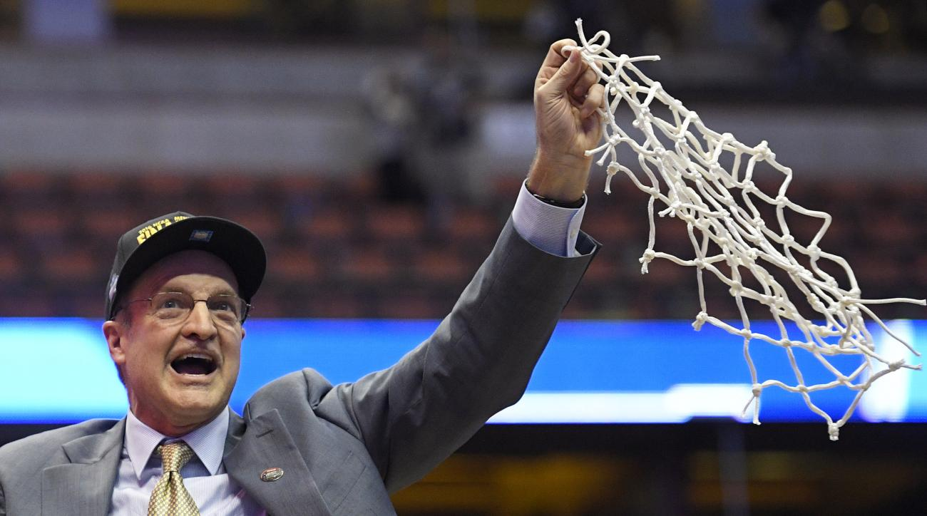 Oklahoma head coach Lon Kruger cuts down the net after their win against Oregon during an NCAA college basketball game in the regional finals of the NCAA Tournament, Saturday, March 26, 2016, in Anaheim, Calif.  (AP Photo/Mark J. Terrill)
