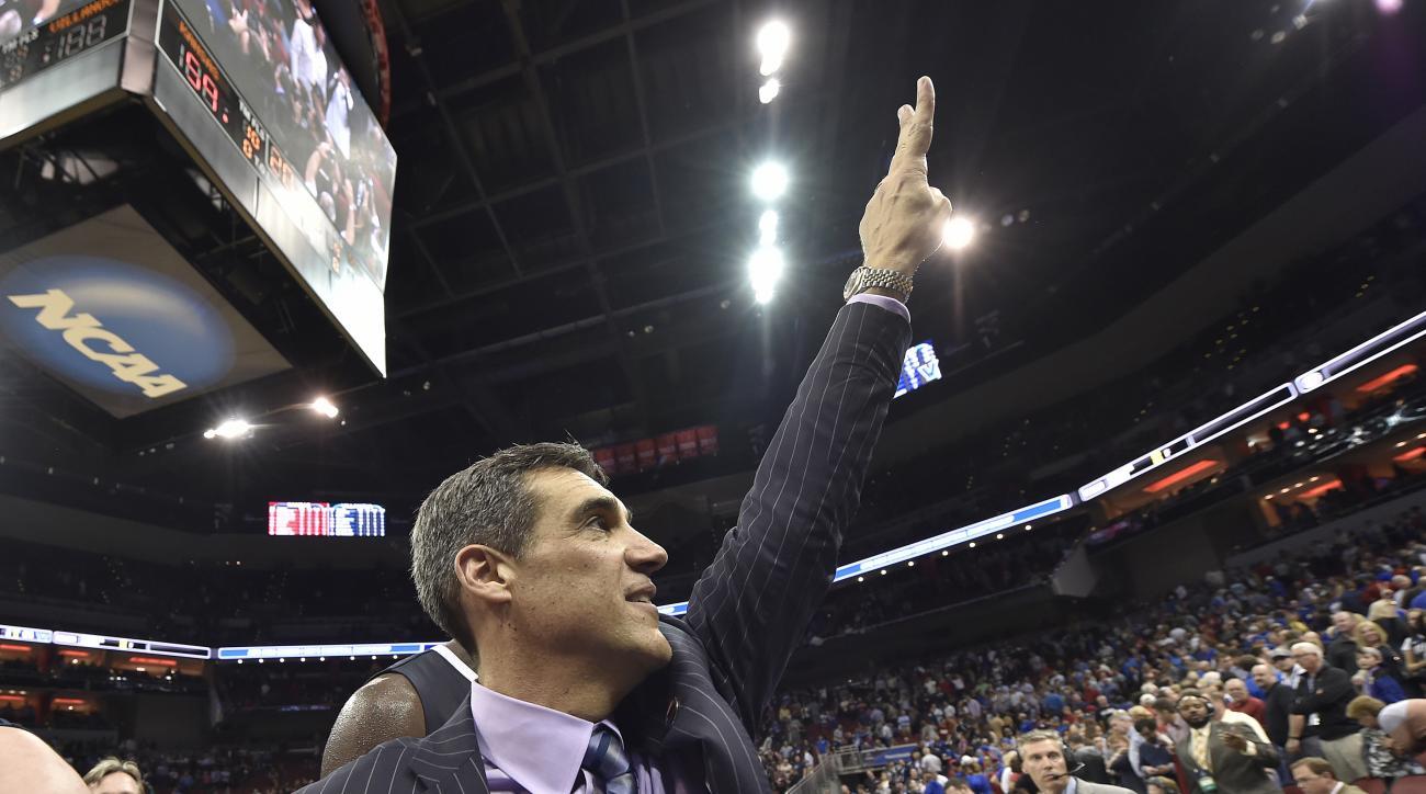 Villanova head coach Jay Wright raises his hand to fans after a regional final men's college basketball game in the NCAA Tournament against Kansas, Saturday, March 26, 2016, in Louisville, Ky. Villanova won 64-59. (AP Photo/John Flavell)