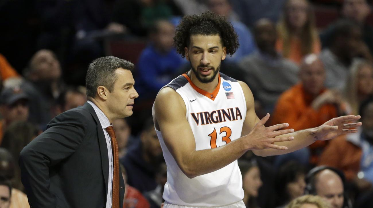 Virginia's Anthony Gill (13) talks to head coach Tony Bennett during the first half of a college basketball game against Syracuse in the regional finals of the NCAA Tournament, Sunday, March 27, 2016, in Chicago. (AP Photo/Nam Y. Huh)