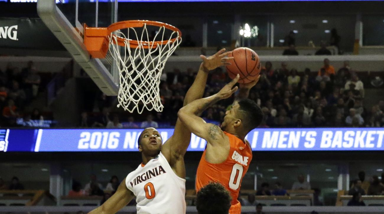 Syracuse's Michael Gbinije (0) shoots over Virginia's Devon Hall (0) during the first half of a college basketball game in the regional finals of the NCAA Tournament, Sunday, March 27, 2016, in Chicago. (AP Photo/Nam Y. Huh)