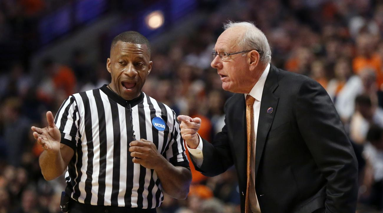 Syracuse's head coach Jim Boeheim argues a call with an official during the first half of a college basketball game against Virginia in the regional finals of the NCAA Tournament, Sunday, March 27, 2016, in Chicago. (AP Photo/Charles Rex Arbogast)