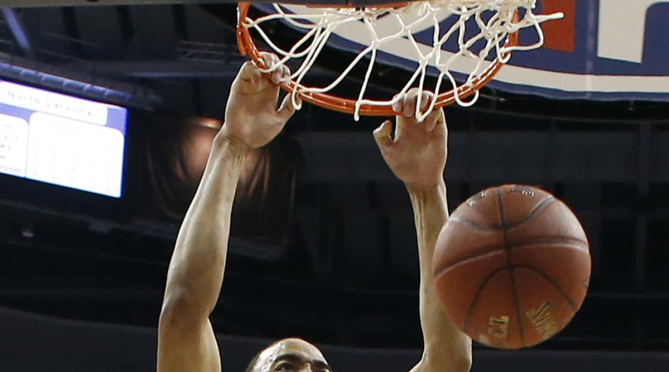 FILE - In this March 10, 2016, file photo, North Carolina forward Brice Johnson (11) dunks the ball in front of Pittsburgh forward Jamel Artis (1) during the first half of an NCAA college basketball game in the Atlantic Coast Conference tournament, in Was