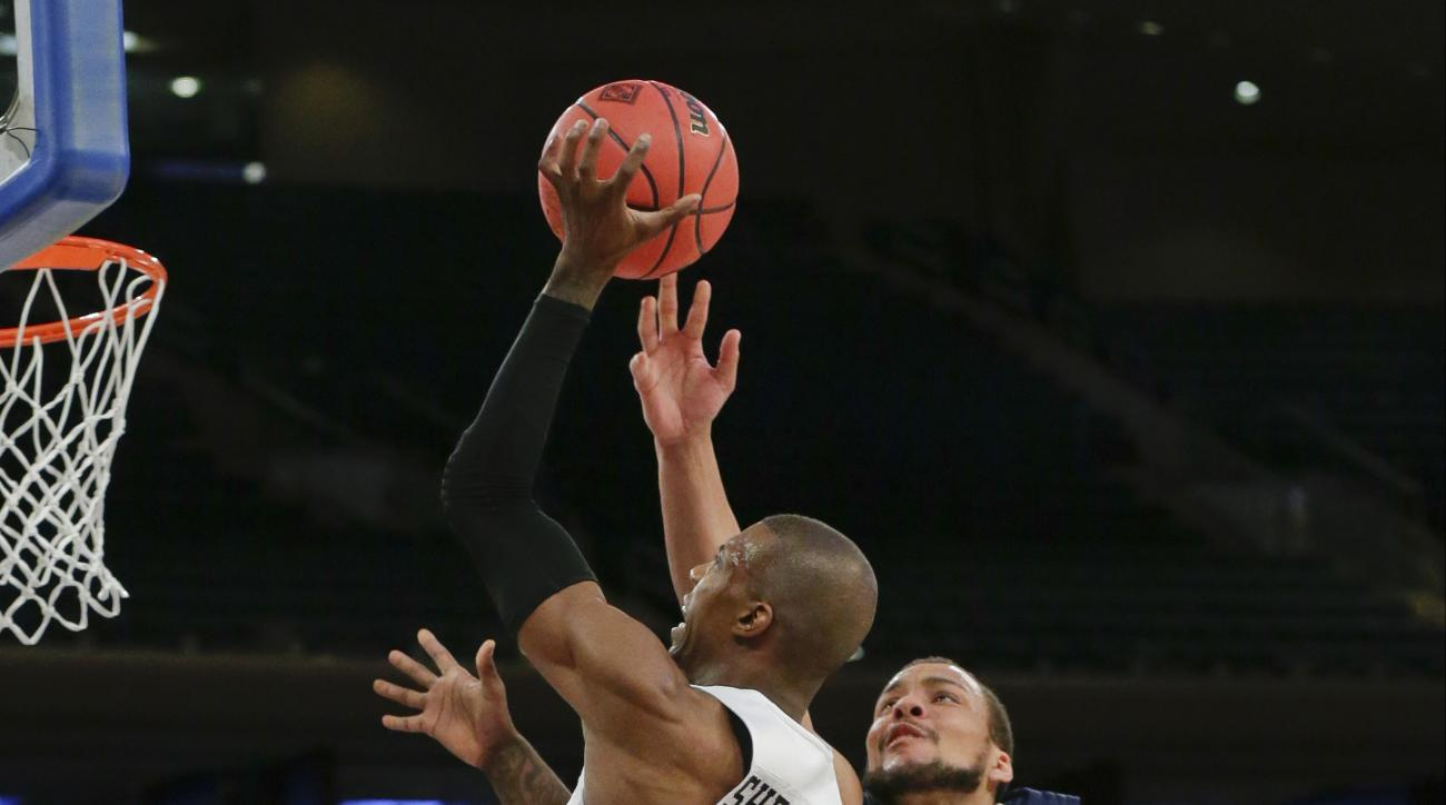 San Diego State's Winston Shepard (13) drives past George Washington's Kevin Larsen (21) during the first half of an NCAA college basketball game in the semifinals of the NIT on Tuesday, March 29, 2016, in New York. (AP Photo/Frank Franklin II)