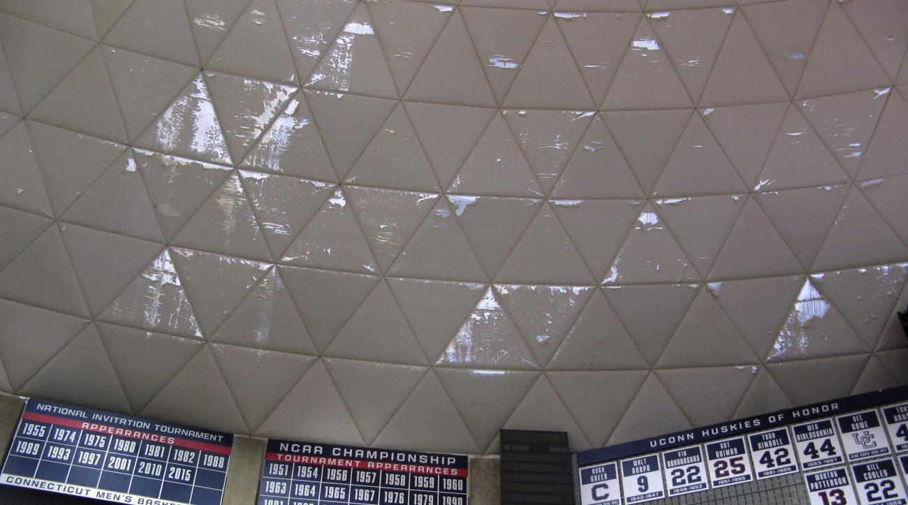 Numerous frayed panels hang in Gampel Pavilion, the University of Connecticut's basketball arena, Wednesday, March 30, 2016, in Storrs, Conn. The school's board of trustees approved plans to spend $10 million to refurbish the arena's aging roof, with work