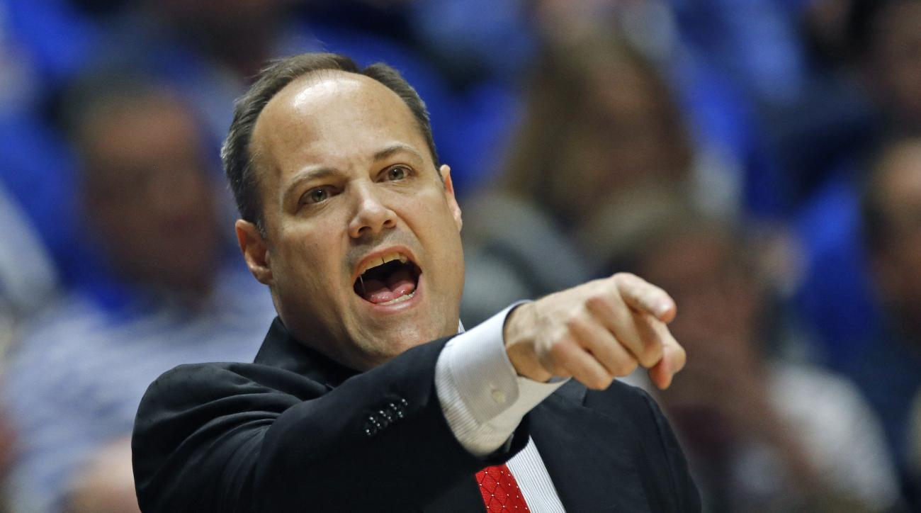 FILE - In this Saturday, March 12, 2016 file photo, Georgia head coach Mark Fox directs his team against Kentucky during the first half of an NCAA college basketball game in the Southeastern Conference tournament in Nashville, Tenn. Georgia athletic direc