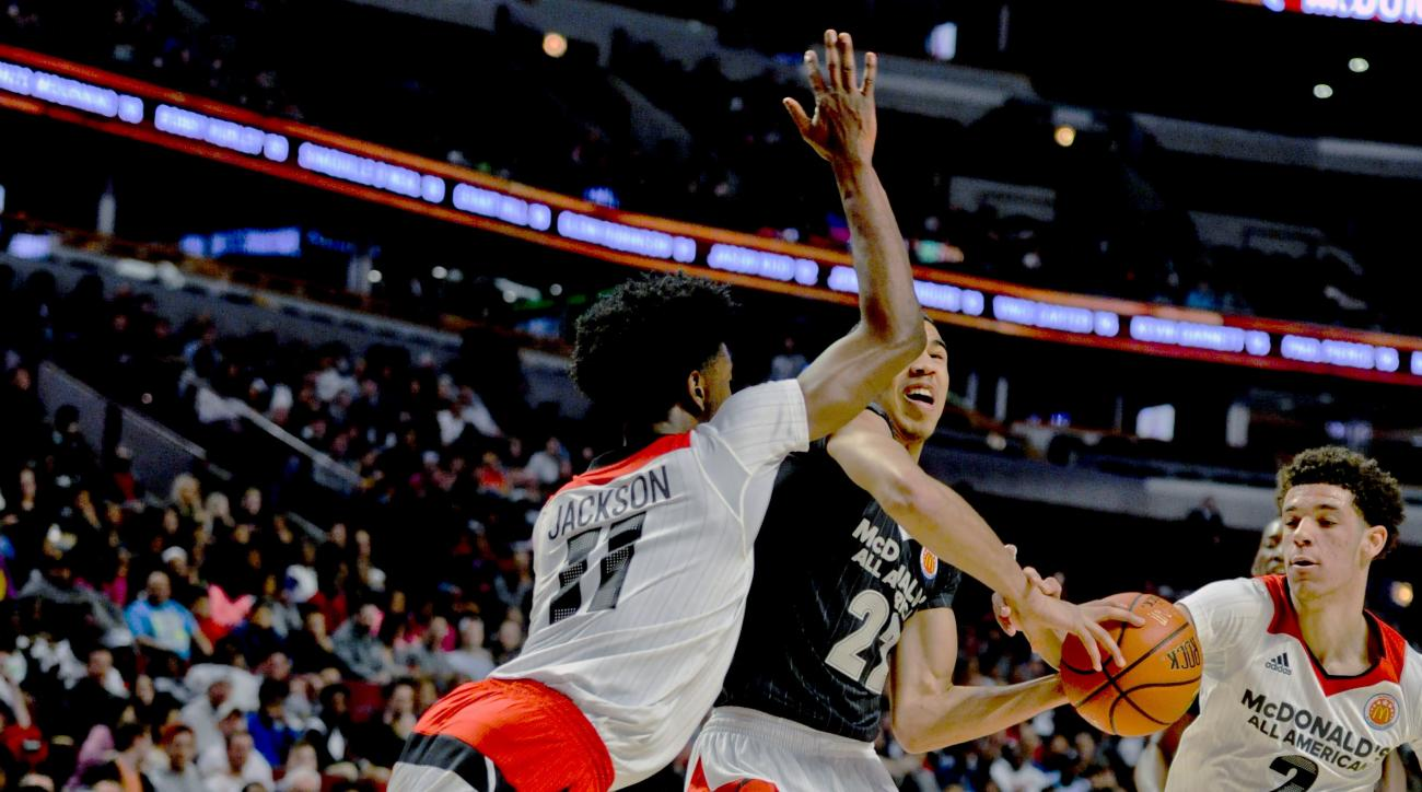 East forward  Jayson Tatum (22) from Chaminade College Preparatory school in St. Louis, shoots against West forward Josh Jackson, left, from Justin-Siena High School/Prolific Prep Academy in Napa, Calif.,  and West point guard Lonzo Ball from Chino Hills