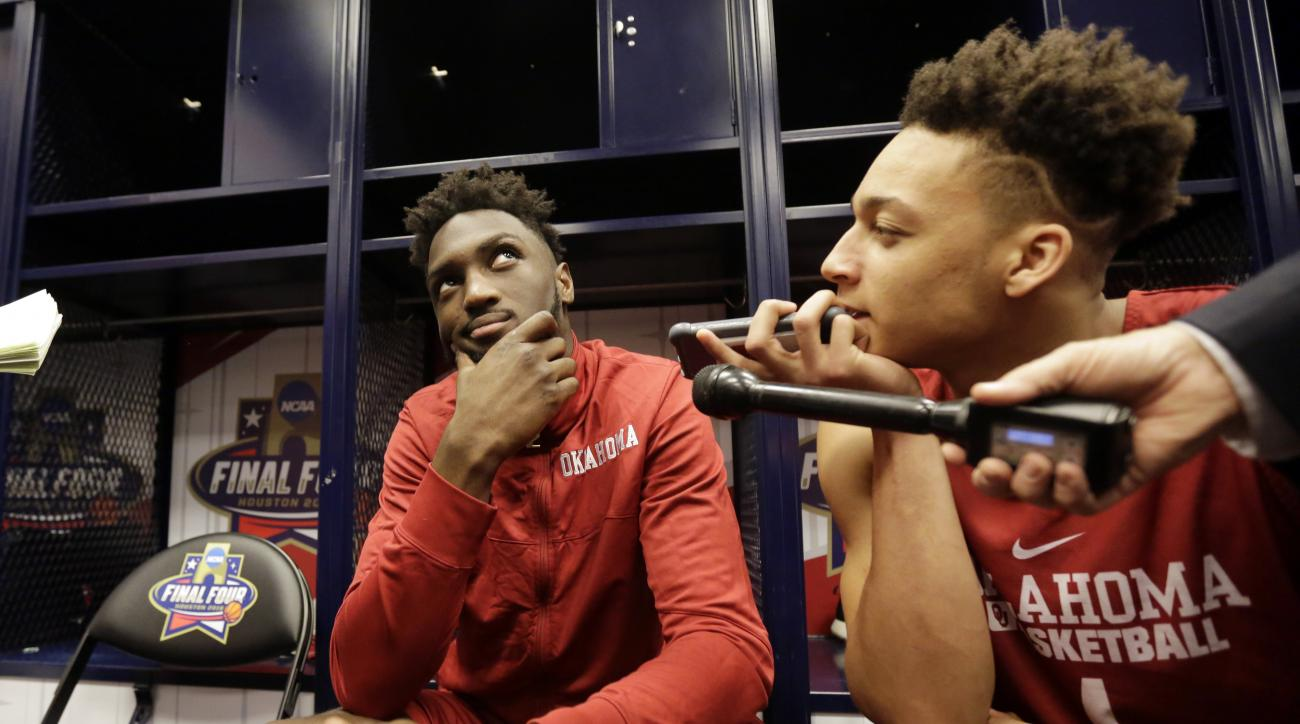 Oklahoma's Khadeem Lattin ponders a question before a closed practice session for the NCAA Final Four college basketball tournament Thursday, March 31, 2016, in Houston. (AP Photo/Eric Gay)