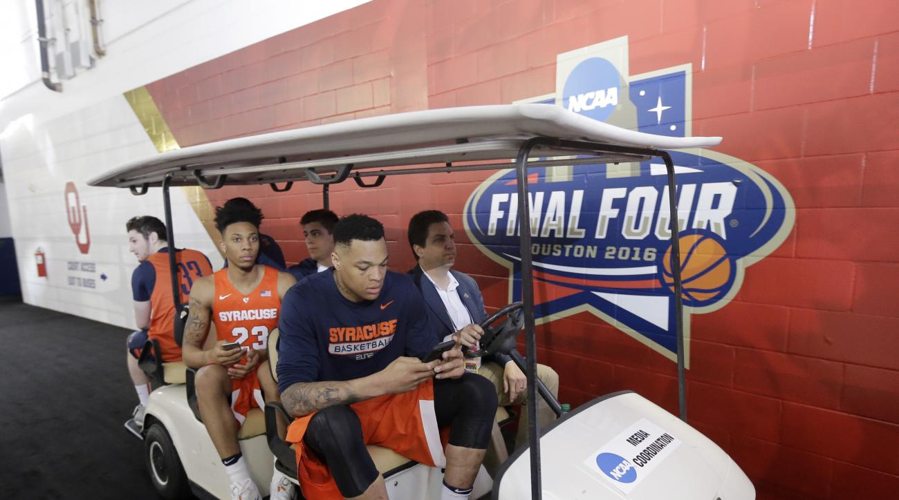Syracuse players make their way to the court for a closed practice session for the NCAA Final Four college basketball tournament Thursday, March 31, 2016, in Houston. (AP Photo/Eric Gay)
