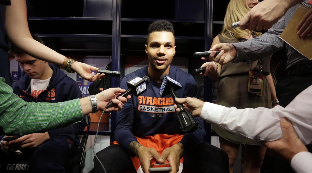 Syracuse's Michael Gbinije answers questions before a practice session for the NCAA Final Four college basketball tournament Thursday, March 31, 2016, in Houston. (AP Photo/Eric Gay)