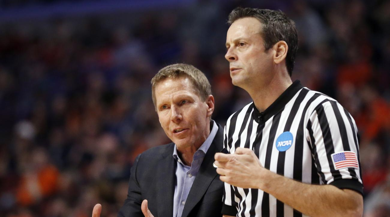 FILE - In this March 25, 2016, file photo, Gonzaga's head coach Mark Few argues a call with an official during the second half of a college basketball game against Syracuse in the regional semifinals of the NCAA Tournament in Chicago. Few tells The Associ