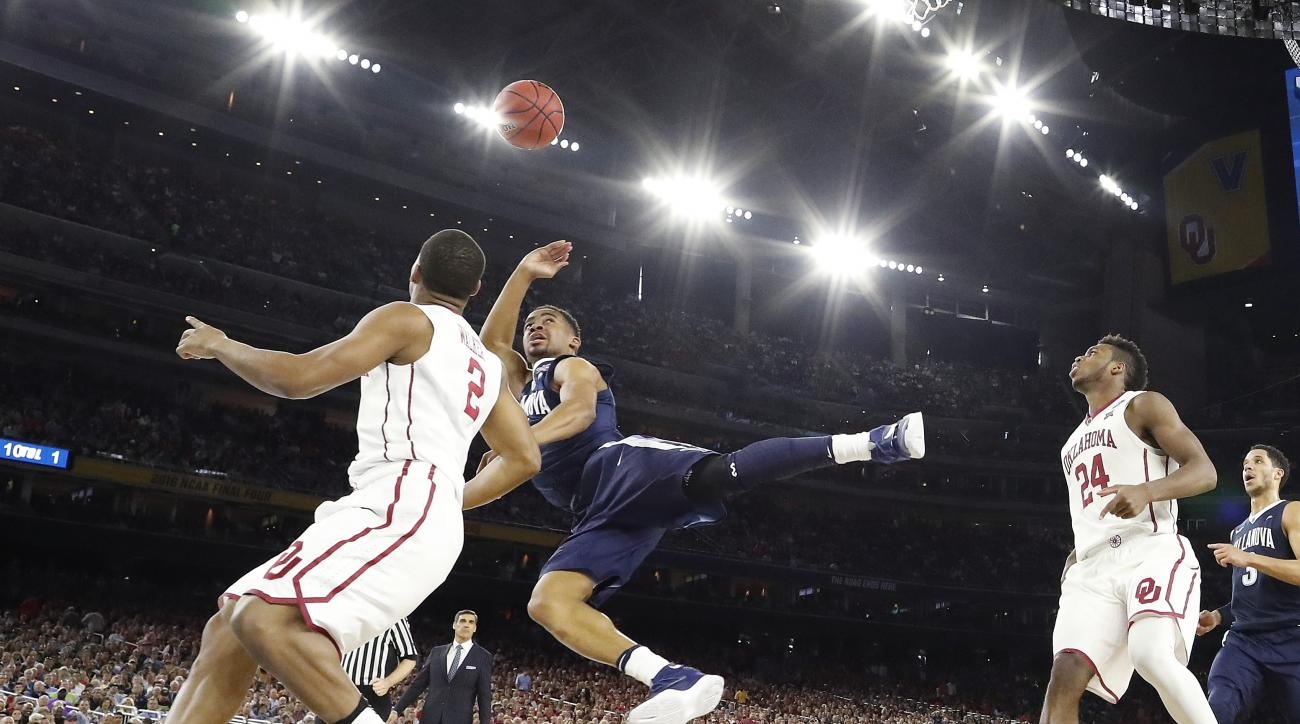 Villanova guard Phil Booth shoots against Oklahoma guard Dinjiyl Walker (2) during the second half of the NCAA Final Four tournament college basketball semifinal game Saturday, April 2, 2016, in Houston. (AP Photo/David J. Phillip)