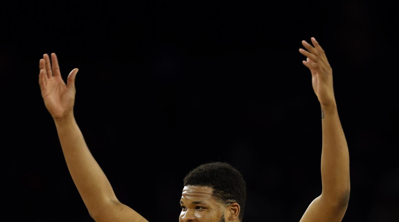 North Carolina's Kennedy Meeks (3) reacts during the second half of the NCAA Final Four tournament college basketball semifinal game against Syracuse, Saturday, April 2, 2016, in Houston. (AP Photo/David J. Phillip)