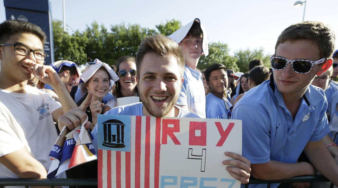 North Carolina sophomore Scott Showwalter holds up a sign as he waits outside NRG Stadium for the NCAA Final Four tournament college basketball championship game between Villanova and North Carolina, Monday, April 4, 2016, in Houston. (AP Photo/Charlie Ne