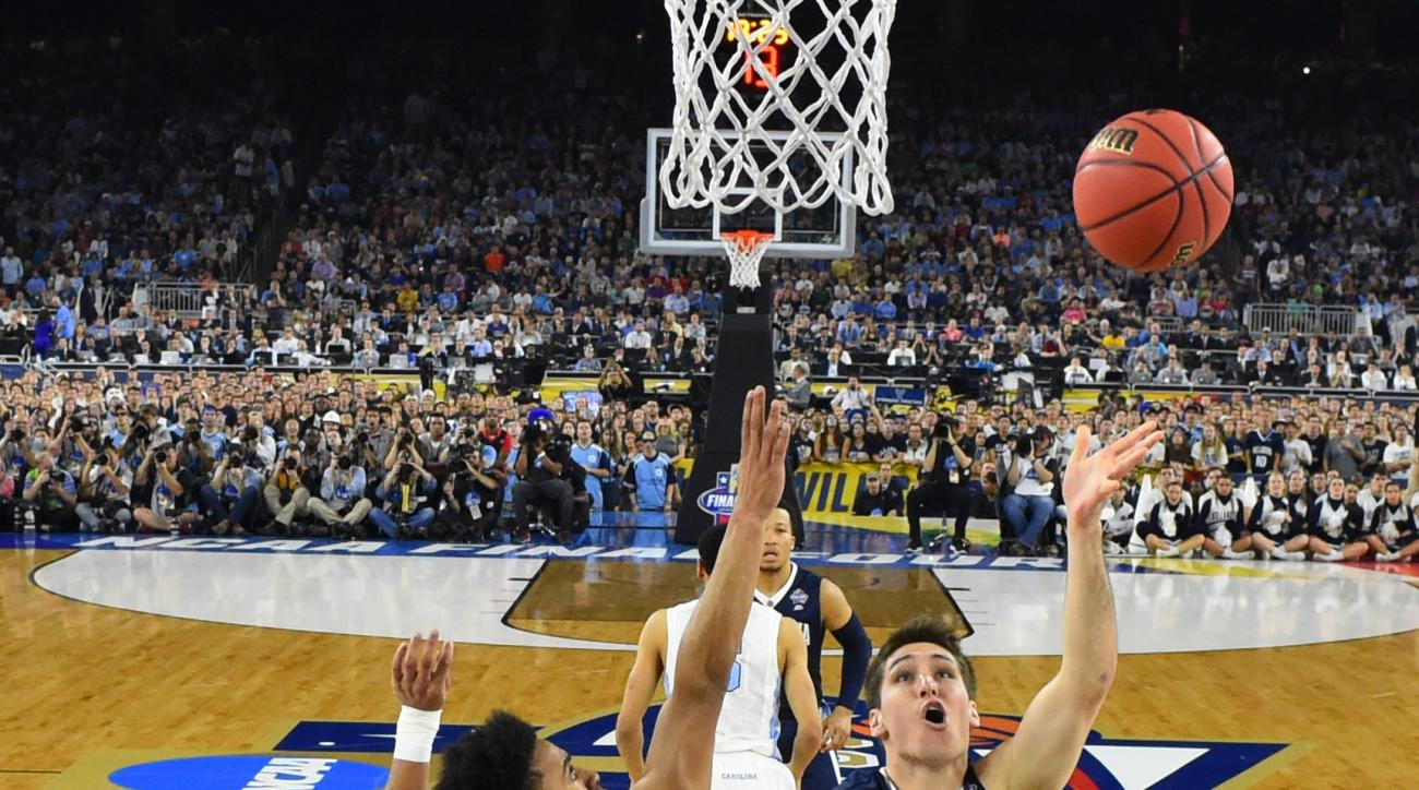 Villanova's Ryan Arcidiacono (15) goes up for a shot against North Carolina's Joel Berry II (2) during the first half of the NCAA Final Four tournament college basketball championship game Monday, April 4, 2016, in Houston. (Robert Deutsch via AP, Pool)