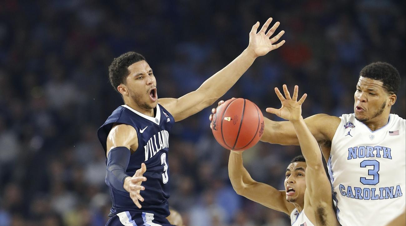Villanova guard Josh Hart (3) North Carolina guard Marcus Paige (5) and North Carolina forward Kennedy Meeks (3) chase a loose ball  during the first half of the NCAA Final Four tournament college basketball championship game Monday, April 4, 2016, in Hou