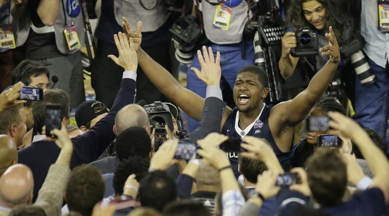 Villanova forward Kris Jenkins celebrates after the NCAA Final Four tournament college basketball championship game against North Carolina Monday, April 4, 2016, in Houston. Villanova won 77-74. (AP Photo/Charlie Neibergall)