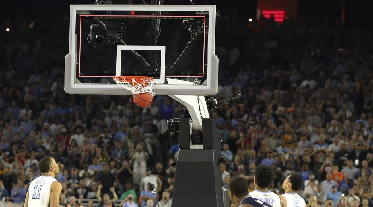 Villanova's Kris Jenkins (2) watches his game winning three point basket at the closing seconds of the NCAA Final Four tournament college basketball championship game against North Carolina, Monday, April 4, 2016, in Houston. Villanova won 77-74. (AP Phot