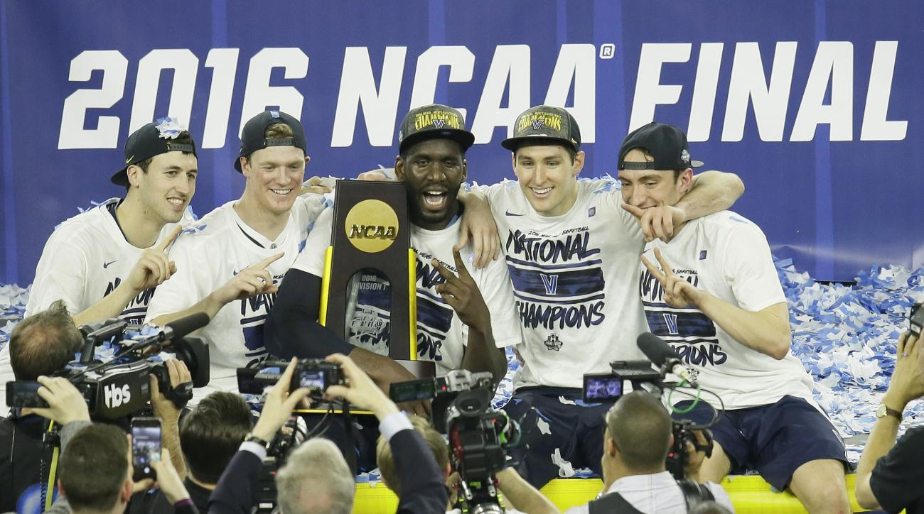Villanova players celebrate after the NCAA Final Four tournament college basketball championship game against North Carolina, Monday, April 4, 2016, in Houston. Villanova won 77-74. (AP Photo/Charlie Neibergall)