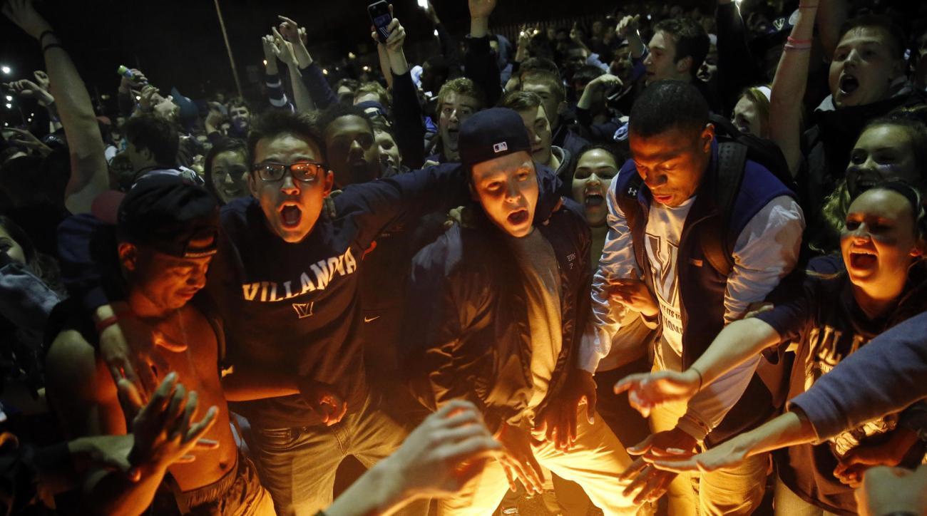 Villanova basketball fans celebrate after Villanova defeated North Carolina in the college basketball championship game of the NCAA Tournament, Tuesday, April 5, 2016, in Villanova, Pa. Villanova won 77-74. (AP Photo/Matt Rourke)