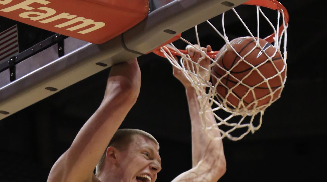 Marquette forward Henry Ellenson gets a slam dunk against Georgetown during the first half of an NCAA basketball game Tuesday, March 1, 2016, in Milwaukee. (AP Photo/Darren Hauck)