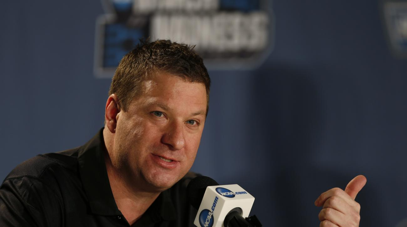 FILE - In this March 18, 2016 file photo, Arkansas Little Rock head coach Chris Beard responds to questions during a news conference as the team prepares for a second-round men's college basketball game in the NCAA Tournament in Denver. Beard has met with