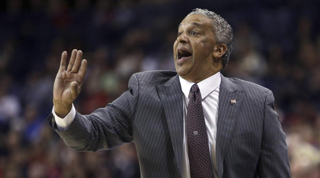 FILE - In this Dec. 7, 2013, file photo, New Mexico State coach Marvin Menzies directs his team against Gonzaga during the first half of an NCAA basketball game in Spokane, Wash. UNLV has moved swiftly to hire a new basketball coach after Chris Beards sud