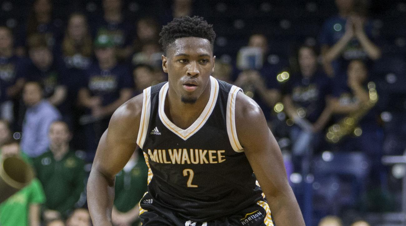 FILE - In this Nov. 17, 2015, file photo, Milwaukees AkeemSprings (2) moves the ball down court during the second half of an NCAA college basketball game in South Bend, Ind.  Springs has joined Minnesota this season as a graduate transfer. The Gophers on