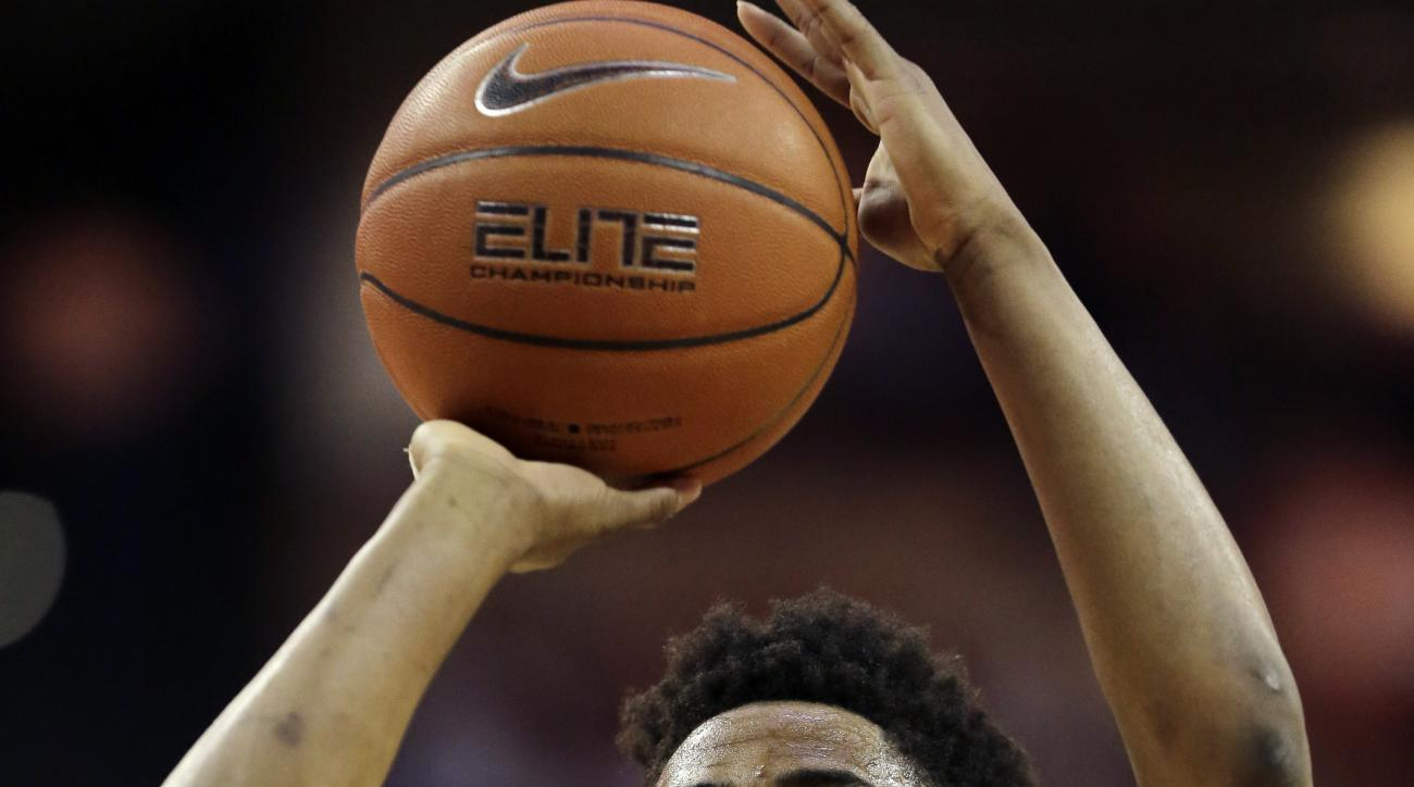 Texas guard Isaiah Taylor (1) shoots a free throw against Oklahoma during the second half of an NCAA college basketball game, Saturday, Feb. 27, 2016, in Austin, Texas. Texas won 76-63. (AP Photo/Eric Gay)