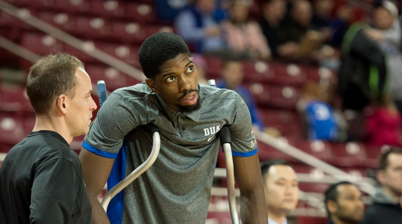 Duke forward Amile Jefferson watches his team warm up before their NCAA college basketball game against Boston College Saturday, Jan. 2, 2016, in Boston. (AP Photo/Gretchen Ertl)
