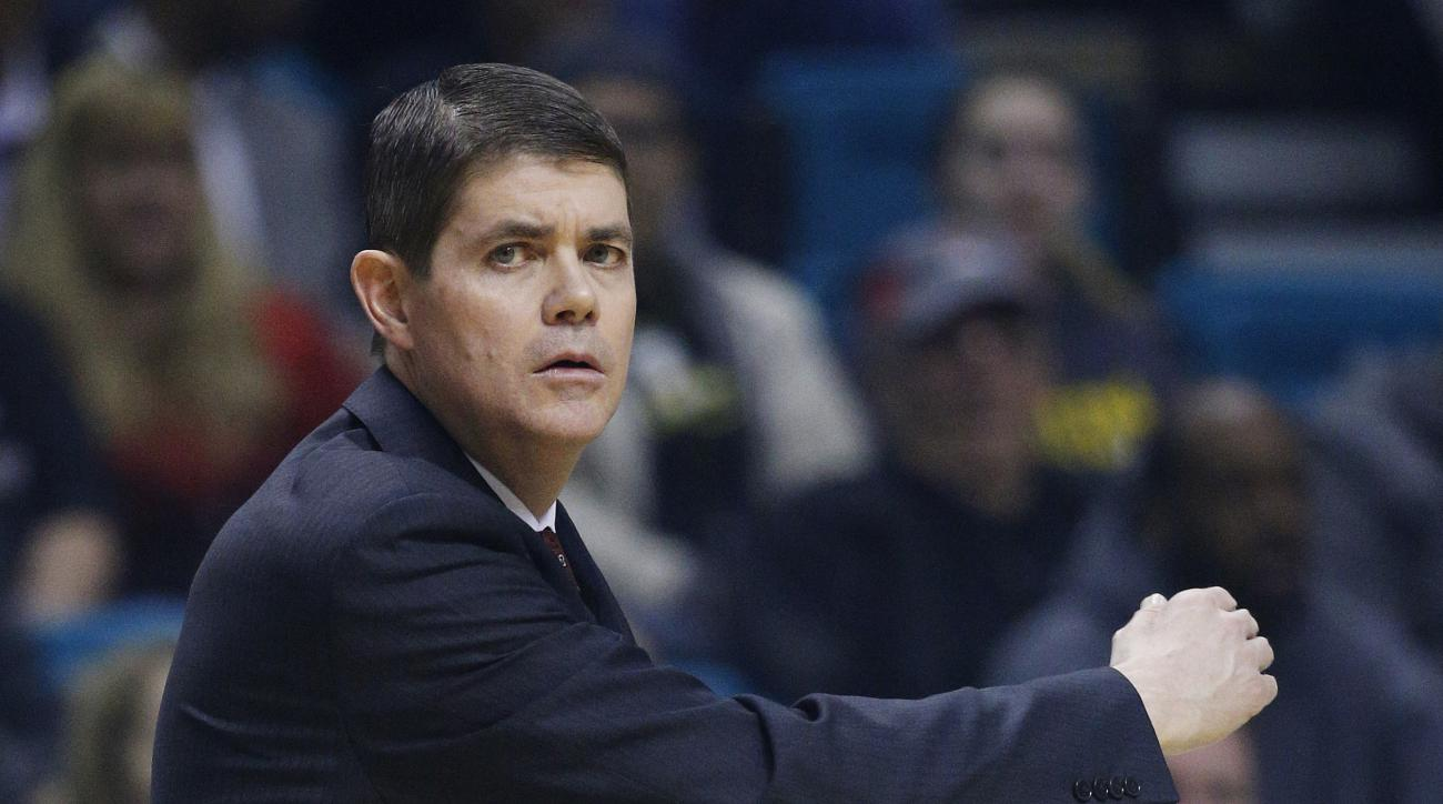 FILE - In this Dec. 4, 2015 file photo, UNLV head coach Dave Rice coaches against Oregon during an NCAA college basketball in Las Vegas. Rice is switching sides in Nevada's biggest basketball rivalry. A person with knowledge of the situation confirmed Mon