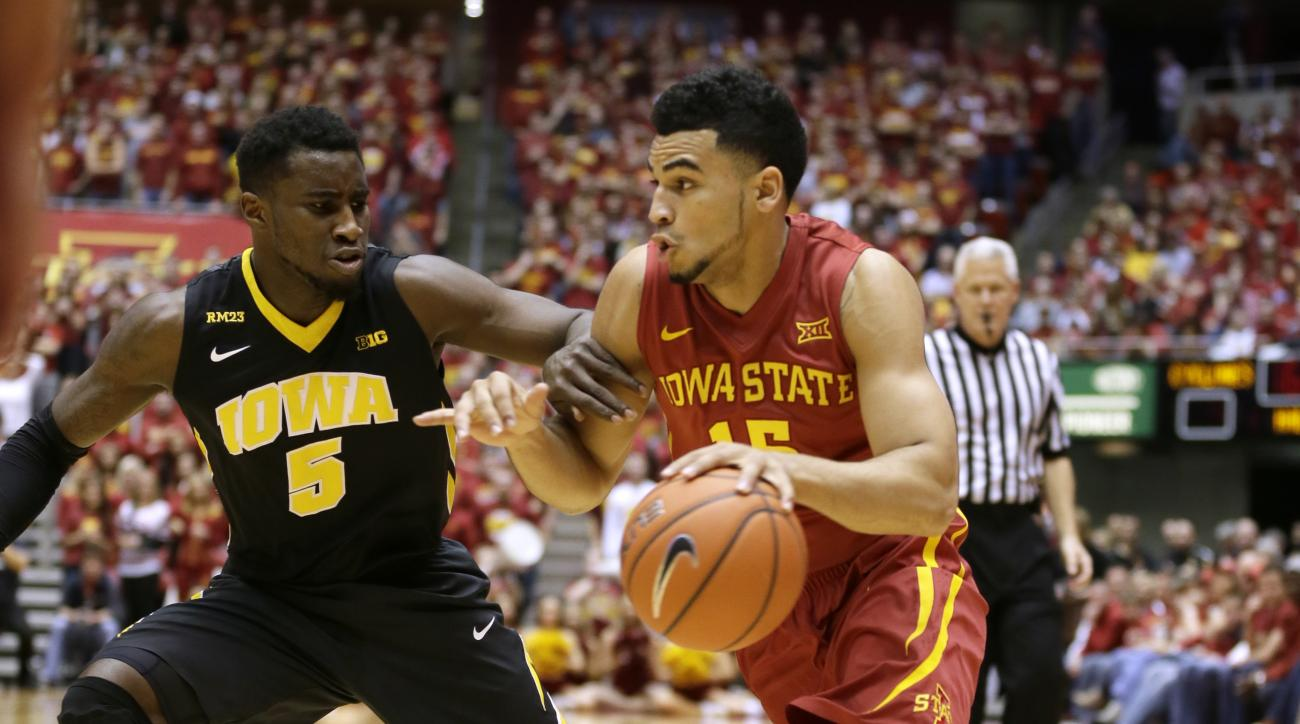 Iowa State guard Naz Mitrou-Long drives past Iowa guard Anthony Clemmons, left, during the first half of an NCAA college basketball game, Thursday, Dec. 10, 2015, in Ames, Iowa. (AP Photo/Charlie Neibergall)