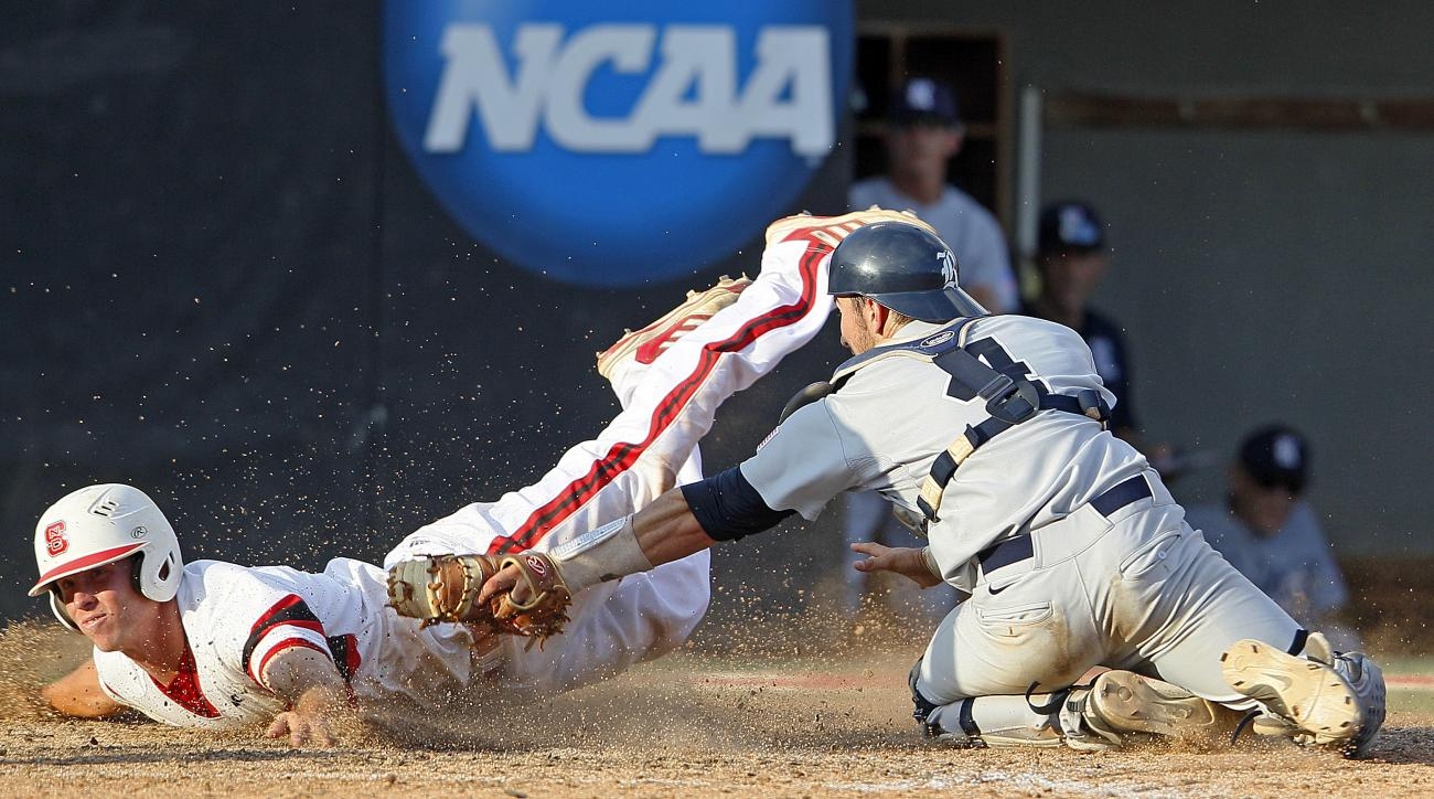 FILE - In this June 8, 2013 file photo, North Carolina State's Brett Williams slides safe into home past Rice catcher Hunter Kopycinski (4) to tie the score in the ninth inning of an NCAA college baseball tournament super regional game, in Raleigh, N.C. T